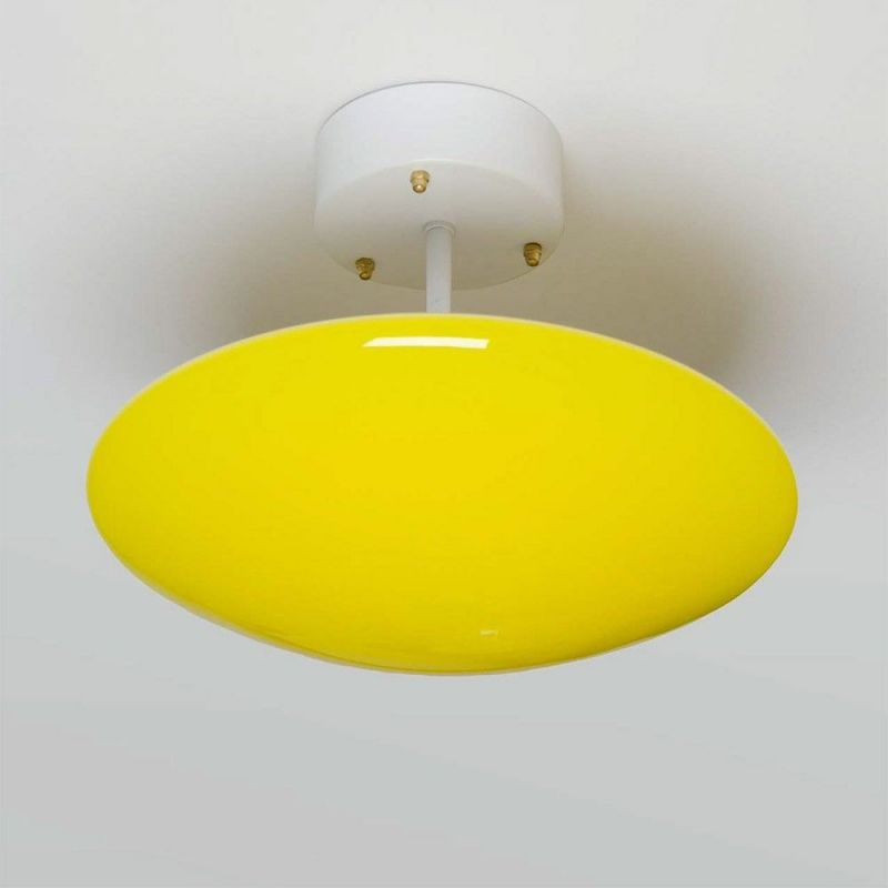 yellow sun wall / ceiling light by atelier areti