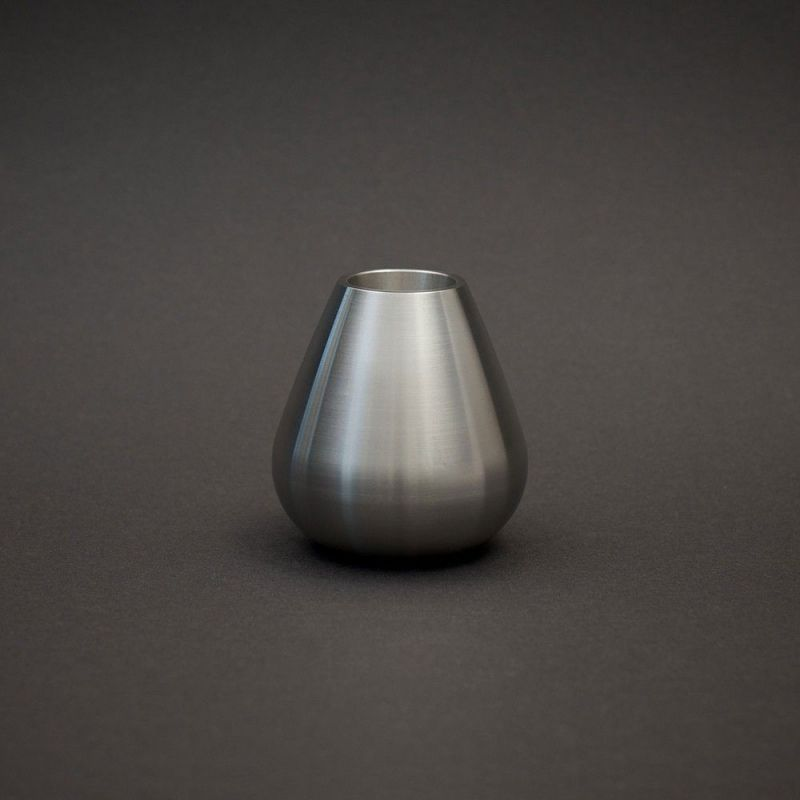 stainless steel candle holder by Matthew Hilton