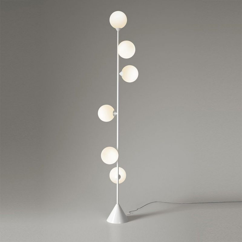 vertical globe floor lamp styled in an interior by atelier Areti