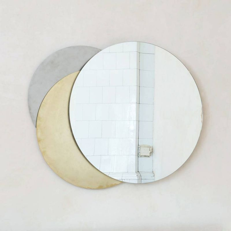 Eclipse mirror wall light by Rooms on white background