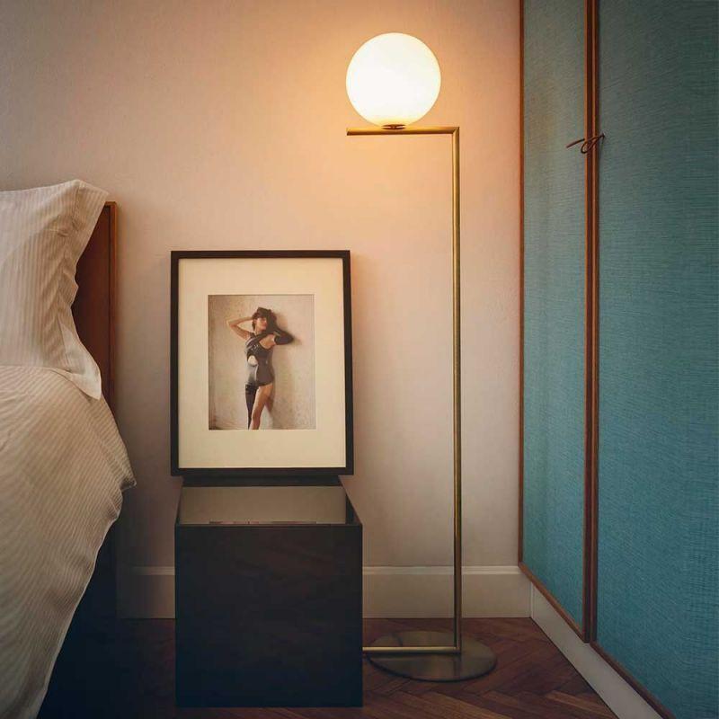 flos ic floor lamp in a bedroom