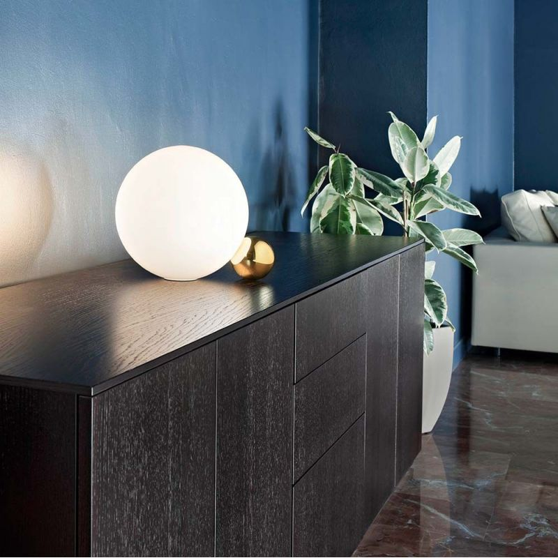 copycat table light in a room by flos