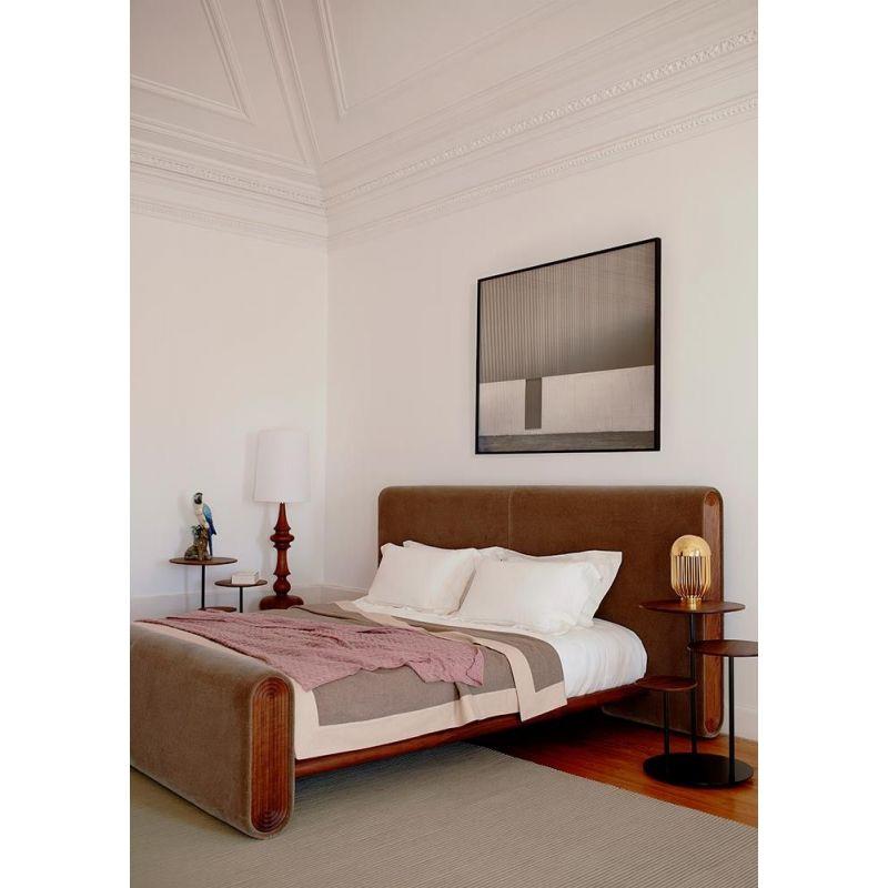 poly side table in a bedroom by de la espada