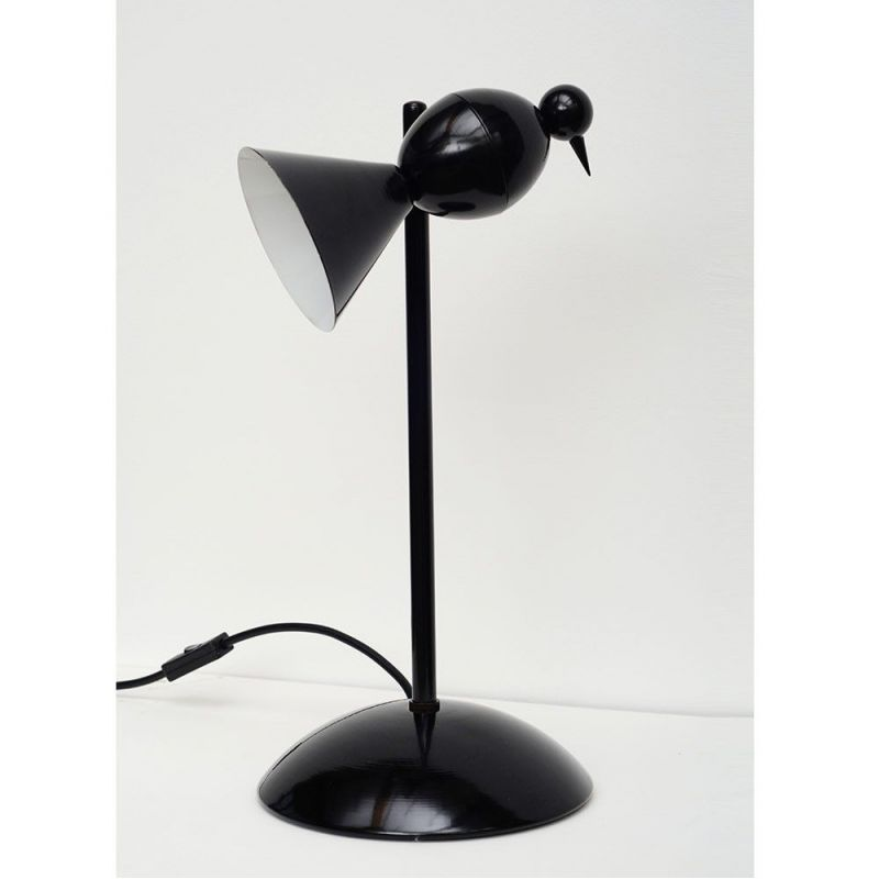 alouette desk lamp sryled in an interior by areti