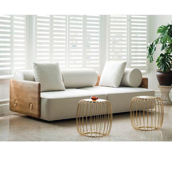 pumkin side table in a sitting room by de la espada