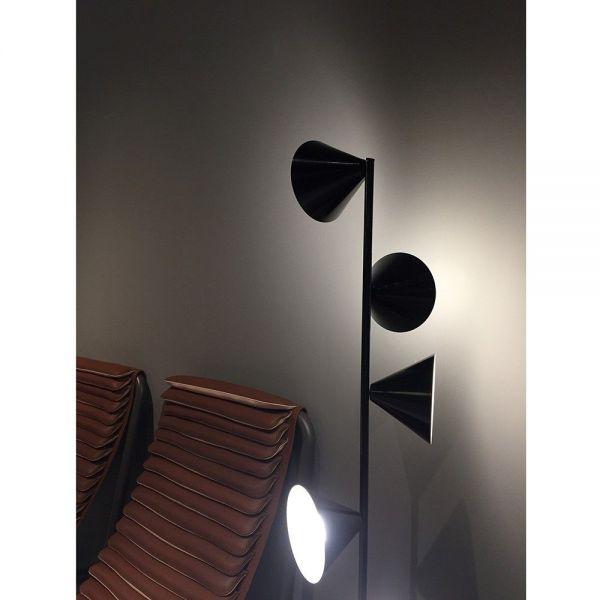 Vertical 1 floor light Areti photographed at the Milan furniture fair