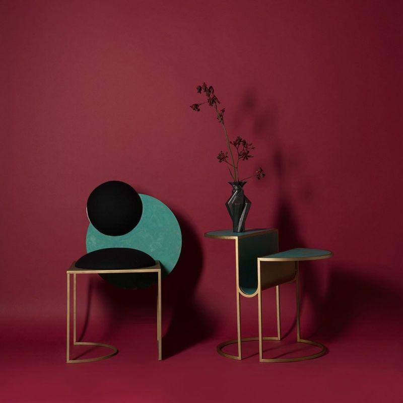 orbit tea table red background by bohinc studio