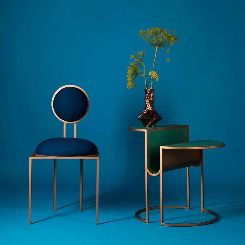 orbit tea table blue background by bohinc studio