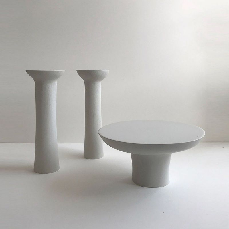 pair of pillar candlesticks by malgorzata bany styled