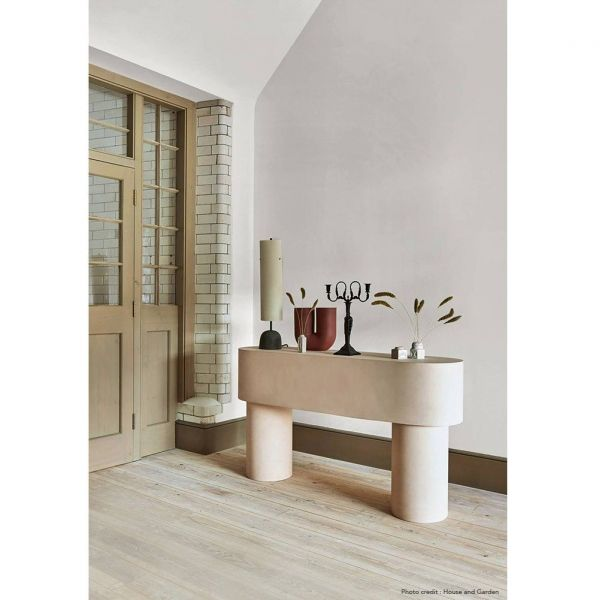 pilotis console side table in a room by malgorzata bany