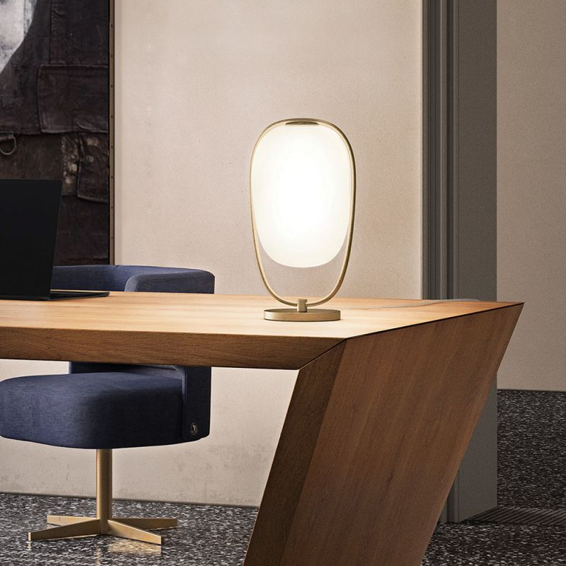 Lanna table lamp by Kundalini on desk