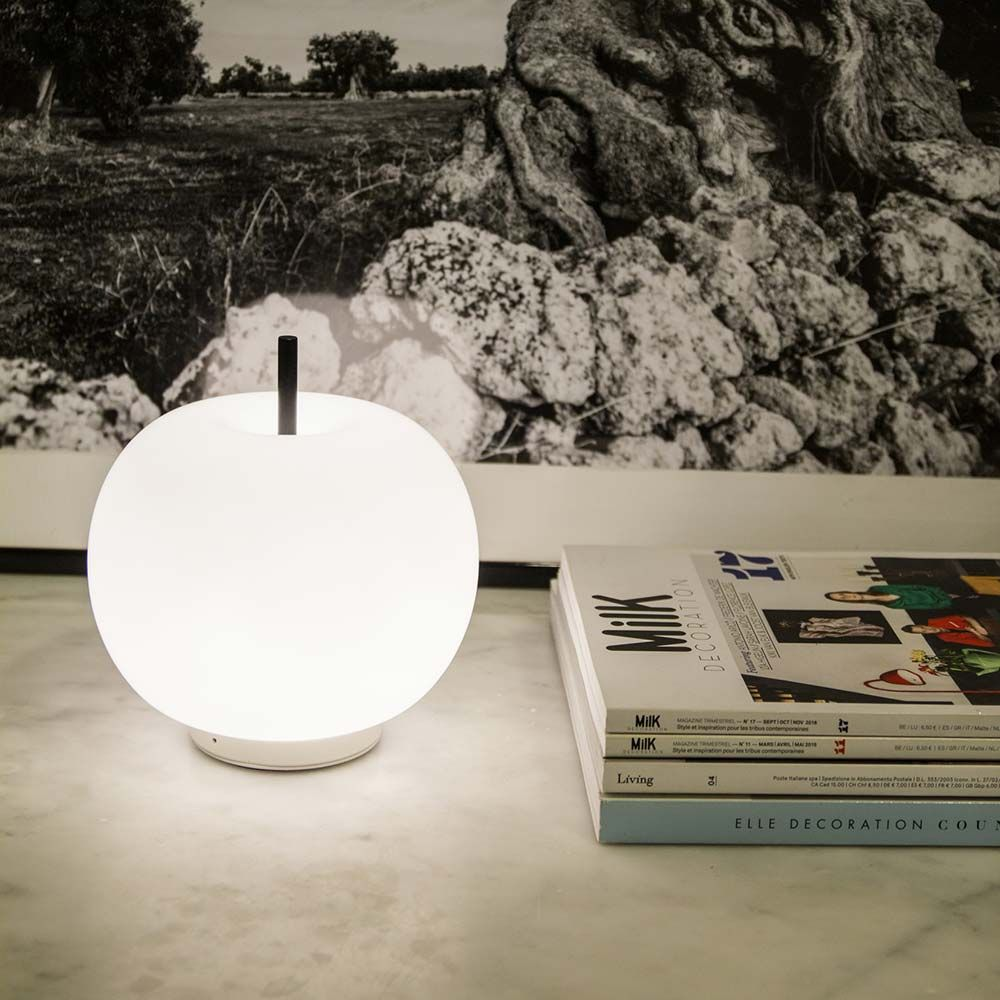 Mobile Kundalini Kushi table lamp styled with magazines