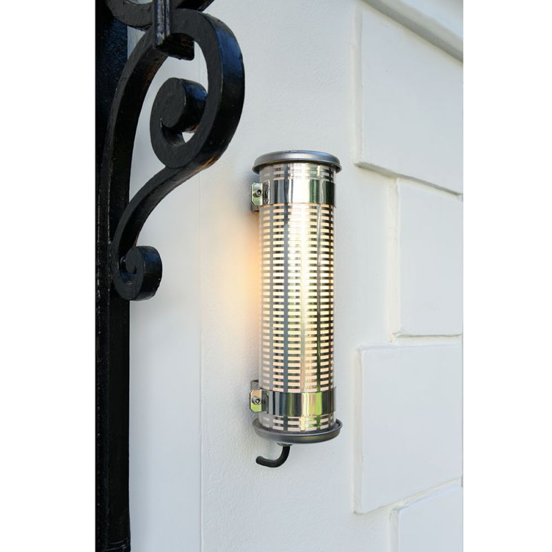 Gude wall light by Sammode photographed by a front door