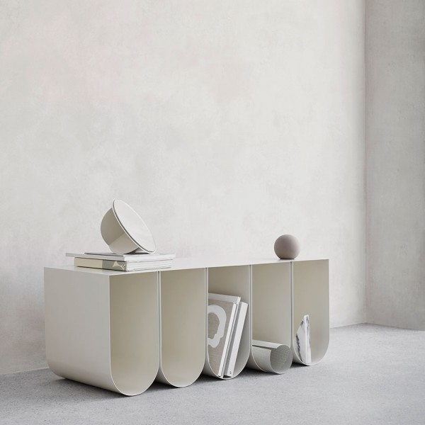The Curved Bench is perfect for storing magazines.