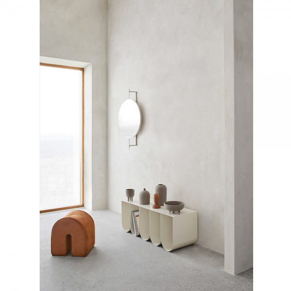 curved poof in a room by kristina dam