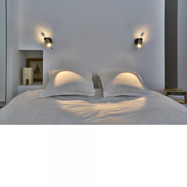 biny spot wall lamp in a room by dcw editions