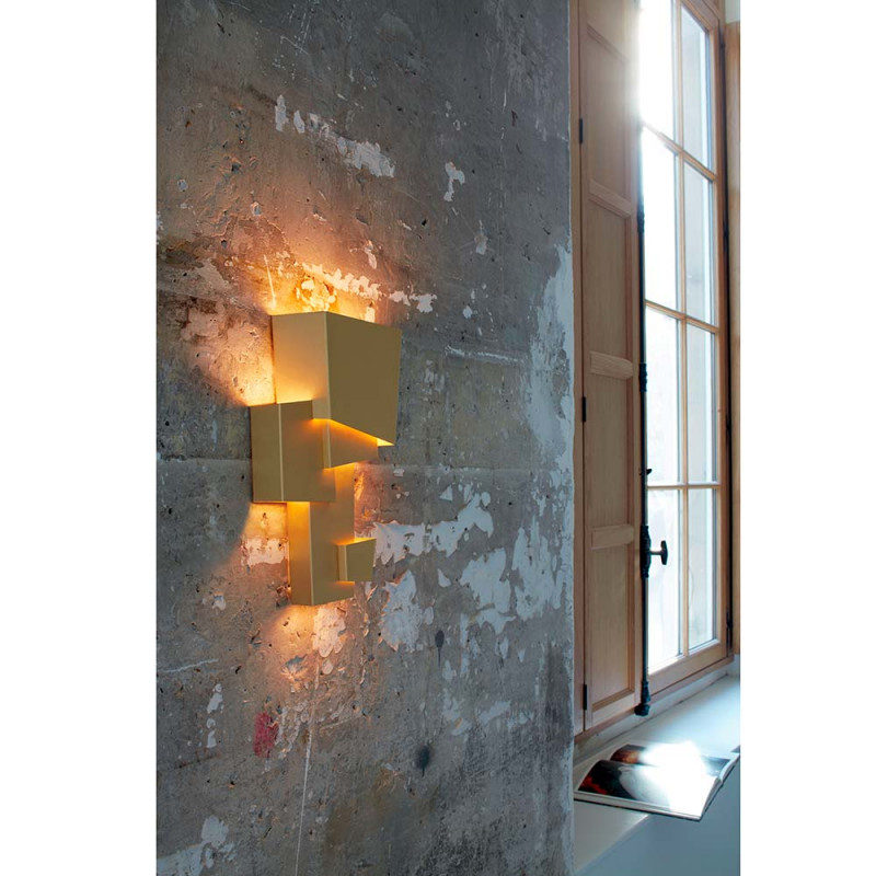 Map 1 wall light by DCW Editions styled against a concrete background
