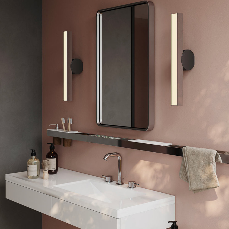 IP Calee Wall Light vertical graphite and brass in the bathroom