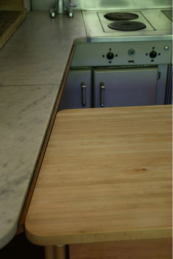 Maison Louis Carré, marble and wood kitchen work surfaces.